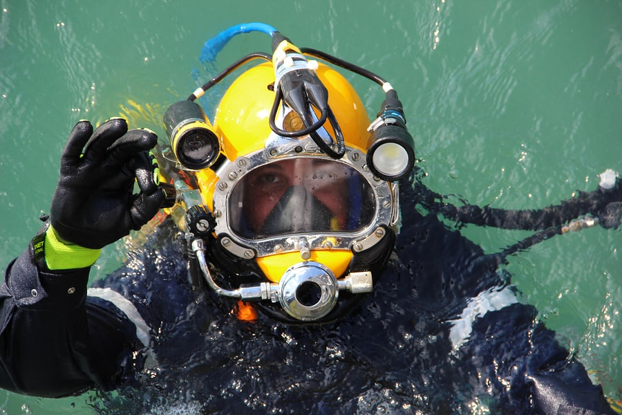 diver in the water in a diving suit